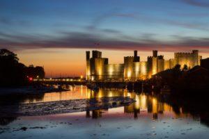 Caernarfon Castle in Wales at sunset