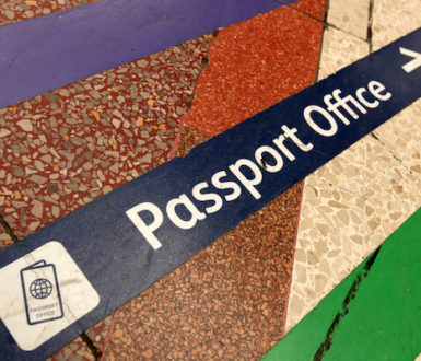 Sign showing the way to a passport office