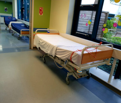 Empty beds sitting in a hospital corridor