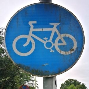 Blue circular sign with a white bike in the centre
