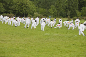 Group of children performing karate in a park