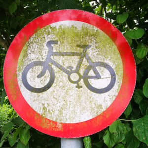 White circular sign with a bike in the centre and a red border