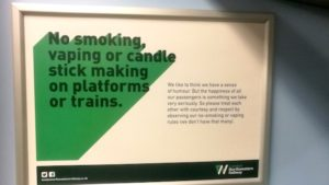 Sign on a train saying 'No smoking, vaping or candle stick making on platforms or trains'