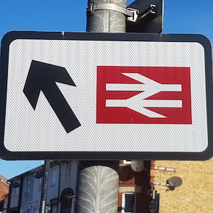 Sign showing British Rail logo and an arrow