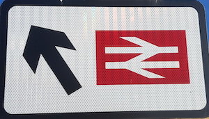 Road sign showing just the British Rail logo and an arrow