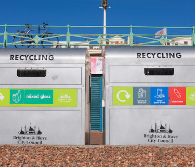 Two large recycling bins on the beach at Brighton
