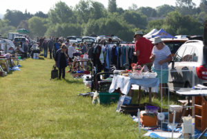 People Shopping At A Car Boot Sale