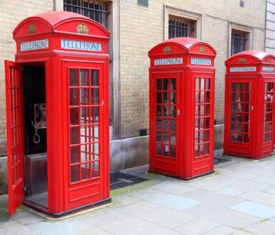 Row of traditional red telephone boxes