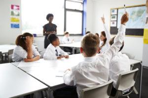 Children wearing school uniform in a classroom