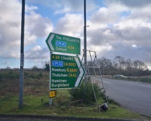 Photo showing a road sign with directions to M roads, A roads and B roads