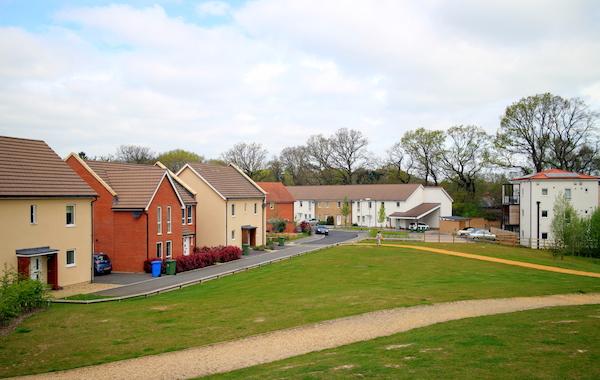 Modern housing development made to look like a village