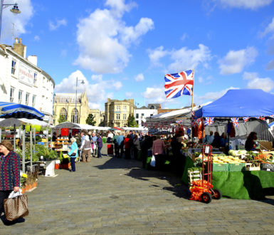 Market in the British town of Boston showing variety of stalls and shoppers