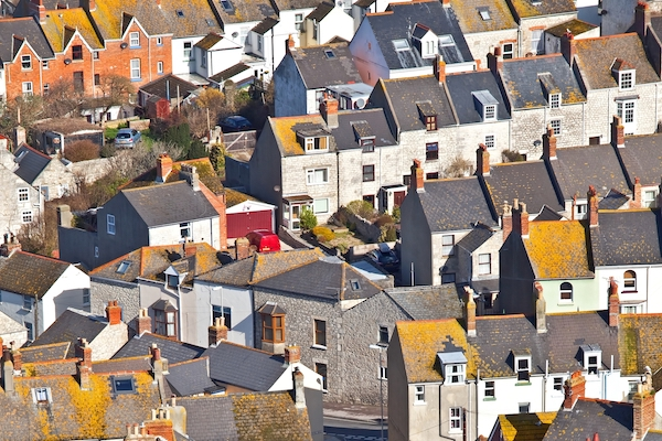 Housing in Britain. Aerial view of terraced houses with slate roofs