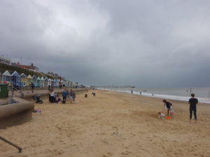 Beach in summer with heavy grey clouds covering the whole sky