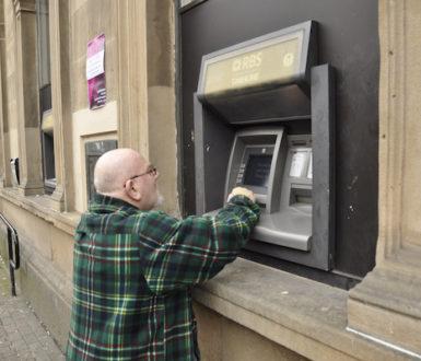 Man using cashpoint