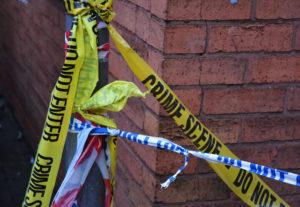 Remnants of crime scene tape left after an incident