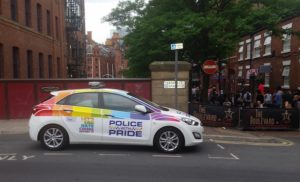 Police car parked by residential street