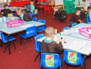 Children in a classroom doing art activities