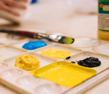 Paintbrush and pallette of paints