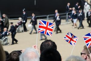 People waving Union Flags at event