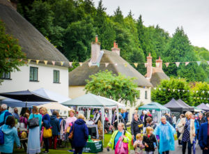People visiting stalls of traditional village fayre