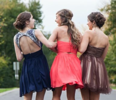 Three young women in party dresses