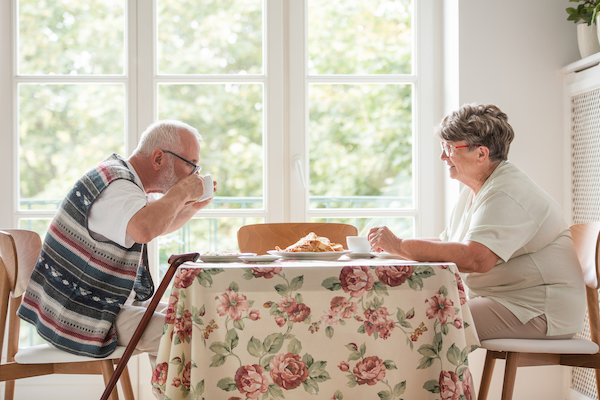 Man and woman having tea together