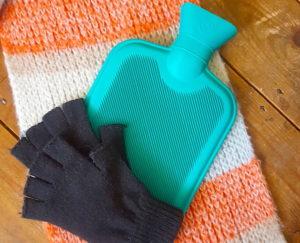 Hot water bottle and fingerless gloves